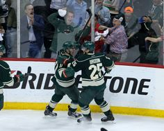 Apr 28, 2014; Saint Paul, MN, USA; Minnesota Wild forward Zach Parise (11) celebrates his goal with defenseman Jonas Brodin (25) during the third period against the Colorado Avalanche in game six of the first round of the 2014 Stanley Cup Playoffs at Xcel Energy Center. The Wild defeated the Avalanche 5-2. Mandatory Credit: Brace Hemmelgarn-USA TODAY Sports