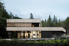 Mixing rustic materials and modern design, the Lachance House reimagines the local architecture of Quebec's Eastern Townships. The exterior's contemporary form is clad in vertical wood planks, left unfinished to weather overtime like the native farm building of the area....