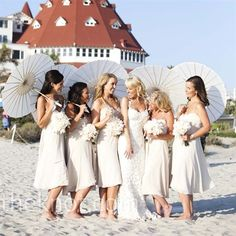 Not a fan of beach weddings, but I absolutely love the bridesmaids dresses (despite the fact they're white), the BRIDE'S DRESS OMG, the umbrellas, the flowers.  Awesome.