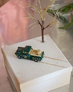 We headed to Pinterest to find beautiful new ways to present your presents. Make an adorable wintry scene on top of your package with a toy car and branch.