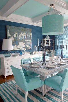Dining Room decor ideas - Coastal, beach style with white, turquoise color palette.  Striped turquoise and white rug.
