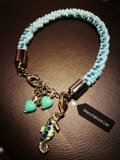 turquoise spring bracelet from beads on kumihimo from Manufaktura Leo Leather Working, Turquoise Bracelet, Leo, Jewelry Making, Charmed, Jewellery, Beads, Spring, Bracelets