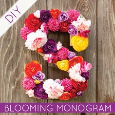 who loves bright colors, flowers + monograms? we do! throw it all together - you've got a blooming monogram! check out the blog to find out how to make this beauty!