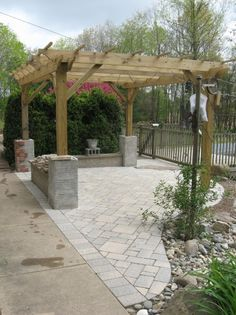 Pergola with cinder block bases then covering with a facade of choice