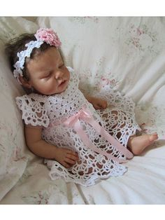 Create an heirloom with this lovely crocheted baby dress and headband. You can stitch this beautiful lacy dress and matching headband using a fingering- or baby-weight yarn. Pattern includes written instructions as well as symbol crochet charts. Sizes: Newborn (3, 6, 9) mos.