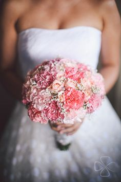 Carnations and roses that came in different shades of pink were used for the bride's bouquet. #weddingbouquet #bouquets | www.BridalBook.ph