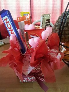 My sister and her best friend (a guy) have always been eachother's valentine. We were trying to come up with something since it wasn't romantic and they had done everything in the book. So we came up with a candy bar bouquet. It was all under $12! Grab a small, thick gift bag and cut the handles off. We put cute rocks inside to weigh it down then added a styrofoam craft ball inside. Bought blooming hearts, candy bars, and skewers for them. We taped the  scewers to the back of the bars and…