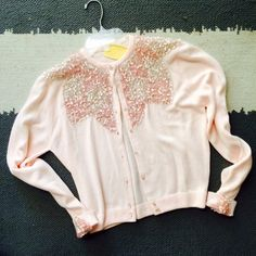 HOST PICKVintage 1950s pink sequin cardigan Vintage 1950s pink sequin cardigan. Great condition. Some minor pinhole stains. Fits a size small. Vintage Sweaters Cardigans