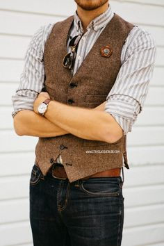 March 28, 2014. Vest: Ludlow Herringbone Wool - J. Crew - $73.50 (similar)Shirt: Frank & Oak - $14Jeans: American Eagle - $29Boots: Maarco - Steve Madden (c/o) (similar, 2)Lapel Flower: Two Guys Bow Ties (c/o)Sunglasses: Ray Ban Clubmaster in Tortoise - $89Watch: Timex Easy Reader - Target - $29 with ASOS watch strap