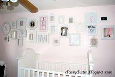 Classy Clutter: What to Do with a Million Frames - Baby girl nursery... So cute what girls room would i do?
