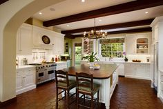 Hexagonal terracotta tiles add to the rustic-chic of this beautiful kitchen.
