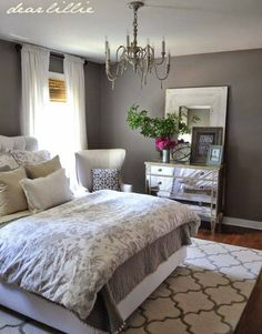 Love the dresser, wall color, carpet and big fluffy bedding!