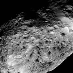 NASA's Cassini spacecraft has returned images from its final close approach to Saturn's oddball moon Hyperion, upholding the moon's reputation as one of the most bizarre objects in the solar system. The views show Hyperion's deeply impact-scarred surface, with many craters displaying dark material on their floors.