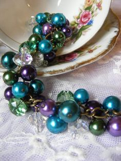 Teal green and purple vintage peacock cluster by LorisJewelryBox, $25.00