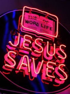 """A neon """"Jesus Saves"""" sign from a St."""