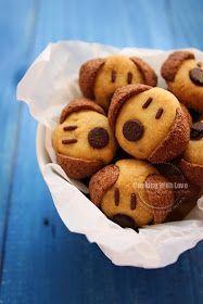 Muffins verzieren - Hund. Schokoreis als Augen, Schokolinsen als Nase, Schokokekse als Ohren. Cereal Doggies Cookies