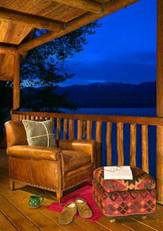 Great views off of the porch of the small log lake house in Whitefish, Montana