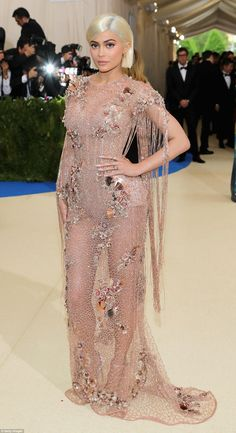 Made an entrance: Kylie Jenner arrived for the 2017 Met Gala in a Versace gown dripping with sea shell and pebble embellishments