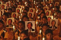 Schoolchildren hold candles and portraits of former South African President Nelson Mandela during a prayer ceremony at a school in the southern Indian city of Chennai, on December 6, 2013. Anti-apartheid hero Mandela died peacefully at home at the age of 95 on Thursday after months fighting a lung infection, leaving his nation and the world in mourning for a man revered as a moral giant. (Reuters/Babu)