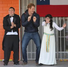 Prince Harry dances, pouts, and plays with children, animals, and firemen in Chile