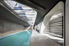 A water feature and skylight allow natural light to illuminate the generous saline-system swimming pool. 520 West Chelsea by Zaha Hadid Architects. Zaha Hadid Architektur, Arquitectos Zaha Hadid, Zaha Hadid Design, Chinese Architecture, Architecture Office, Architecture Quotes, Office Buildings, Futuristic Architecture, Luz Natural