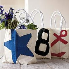 Recycled sail cloth bags-holds all your stuff for a weekend getaway. Maybe I can make these once out of our sails One day!