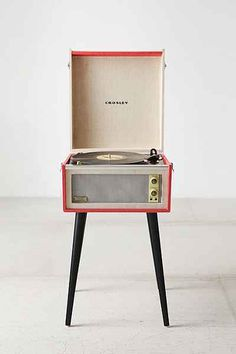 Crosley Dansette Bermuda USB Vinyl Record Player - Urban Outfitters. Might not be what you're looking for, but on the off-chance...a portable record player?