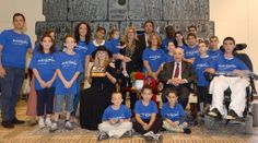 President Peres and Barbra Streisand together with children from the Make-A-Wish foundation
