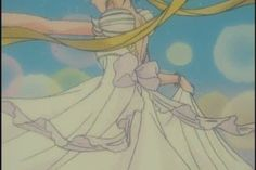 """Details of Princess Serenity's white dress including pink bow & ribbons from """"Sailor Moon"""" series by manga artist Naoko Takeuchi."""