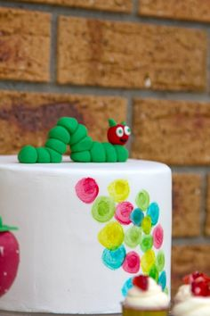 Darling cake at a Very Hungry Caterpillar Party with Such Cute Ideas via Kara's Party Ideas | KarasPartyIdeas.com #VeryHungryCaterpillar #PartyIdeas #PartySupplies #FirstBirthday #cake