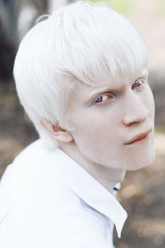 Most popular tags for this image include: albino, eyes, russian Model, white hair and white skin