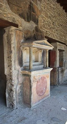 Pompeii, House of the Golden Cupids. The Lararium is shaped like a temple on a podium & frescoed w/a large circle. Side view showing the 2nd story & mosaic pavement; 79 CE
