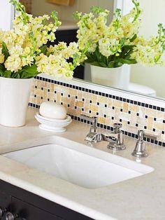 Decorative tile can easily add flare to a simple bathroom. More small-bathroom decorating ideas: http://www.bhg.com/bathroom/small/small-bathroom-decorating-ideas/?socsrc=bhgpin062513rowoftile