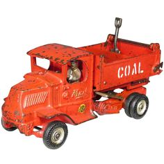 Large Arcade Toys Cast Iron Truck. Mack Coal Truck, red. Comes with shovel. Very good original condition. 10 inches long.