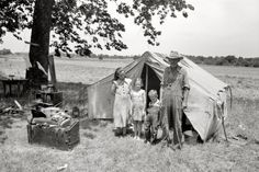 """June 1939. """"Wagoner County, Oklahoma. Veteran migrant agricultural worker and his family encamped on the Arkansas River."""""""