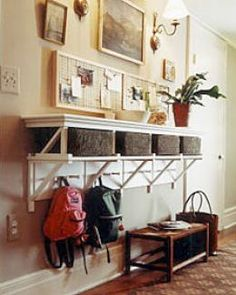 Kind of love this idea - we always need a place to store packpacks and kid gear but you still get to have an entry way table to drop the adults' stuff onto.
