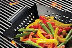 "It's hip to be square with this 8"" x 8"" mini grill wok, a perfect size for grilling veggies and meats for two people, or sides for the entire family. Able to wi"