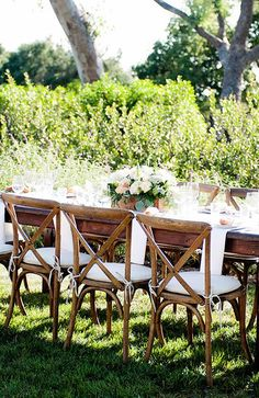 Outdoor reception tables with linens | @angiesilvy | Brides.com