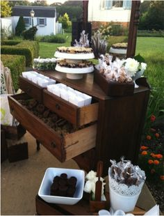 Sweet Station displayed in an old dresser. Guests were able to fill bags with sweets to take with them as favors. // By: Canards Catering and Event Production // canardscatering.com