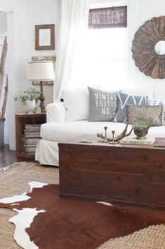 Layered Rugs add warmth and character to this farmhouse living room - Rooms For Rent blog