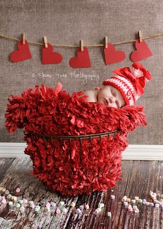 Newborn Red and Pink Valentine's Day Hat with Ribbon and Heart Buttons. $24.00, via Etsy.