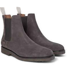Common Projects' Chelsea boots will make a considered addition to your footwear - they're the perfect partner for both smart and casual looks. Timeless and clean-cut, this charcoal pair has been crafted in Italy from durable suede and fitted with elasticated sides to ensure a comfortable fit. Wear them with tailored trousers to the office or with jeans on an evening out.