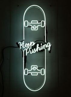 """Keep pushing"" cursive font is an old school apporach. I like the flow of the phrase ""Keep Pushing"""