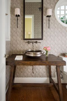 A neutral palette, subtle patterns, exposed beams and arched doorways play up this historic 1920s home's Tudor style.