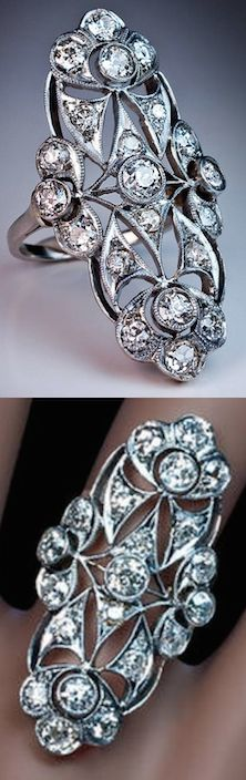*Antique French Long Diamond Ring, Circa 1915, Of an ornate openwork design, crafted in platinum and 18K gold, set with old European and cushion cut diamonds.  Total estimated diamond weight 2.35 ct. Marked with dog's head French platinum mark. Height 38 mm (1 1/2 in.)
