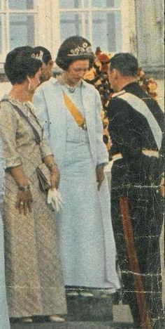 A coloru image of Grand Duchess Josephine Charlotte, wearint eh mystery floral tiara in 1967, Princess Marina of Kent is standing beside her wearing the Cambridge sapphires.