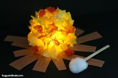 Kids love making and playing with this glowing campfire craft! It's super easy to make and perfect for summer, fire safety week, summer camp, or for imaginative play!