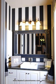 Black and white striped bathroom.