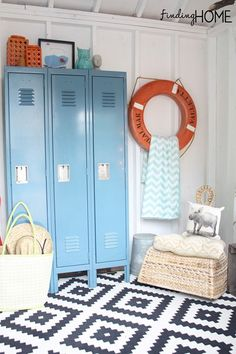 This pool house is decorated so beautifully! The orange life raft is a HomeGoods find!