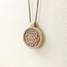 Lotus flower necklace with earthy ceramic ohm by GypsyTribeJewelry, $28.00